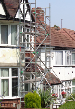 Scaffolding tower - typical costs £90 hire plus £30 delivery plus labour to assemble