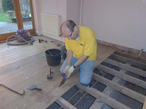 Cutting tongue and groove floorboards with a floorboard saw