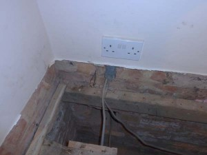 Skirting board removed to allow release of floorboards trapped underneath
