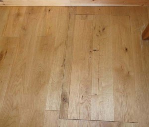 The access hatch in the oak floor was installed at the same time as the oak floor