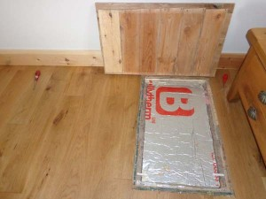 Access hatch with cover removed showing PIR thermal insulation board