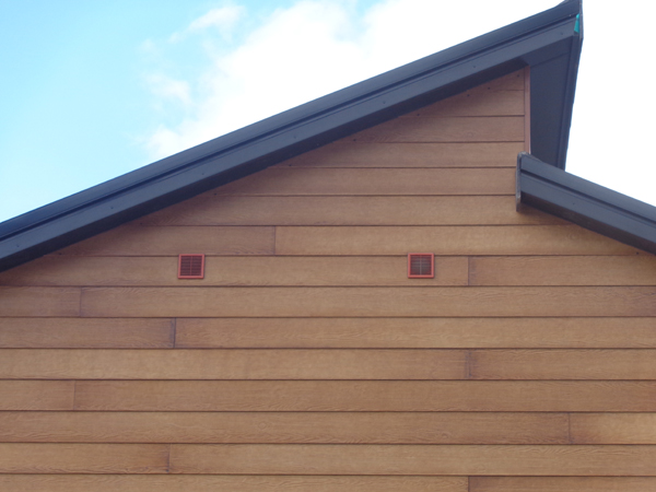 Inlet And Outlet Vents For MVHR System On Side Of House
