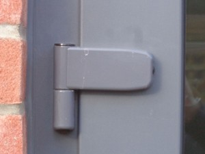 Exterior door hinge adjustable in 3 dimensions