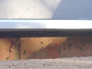 Close Up View Under Door Sill Before Sealing