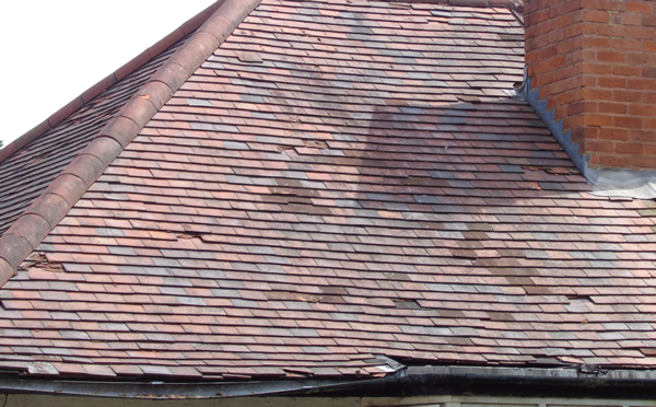 Clay roof needing tiles replacing and new guttering
