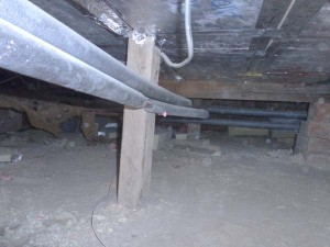 Central heating pipes in process of being insulated with pipe insulation
