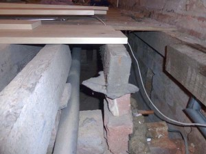 Joist suspended precariously on a brick