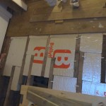 Thermal insulation board cut round joists either side of a sleeper wall