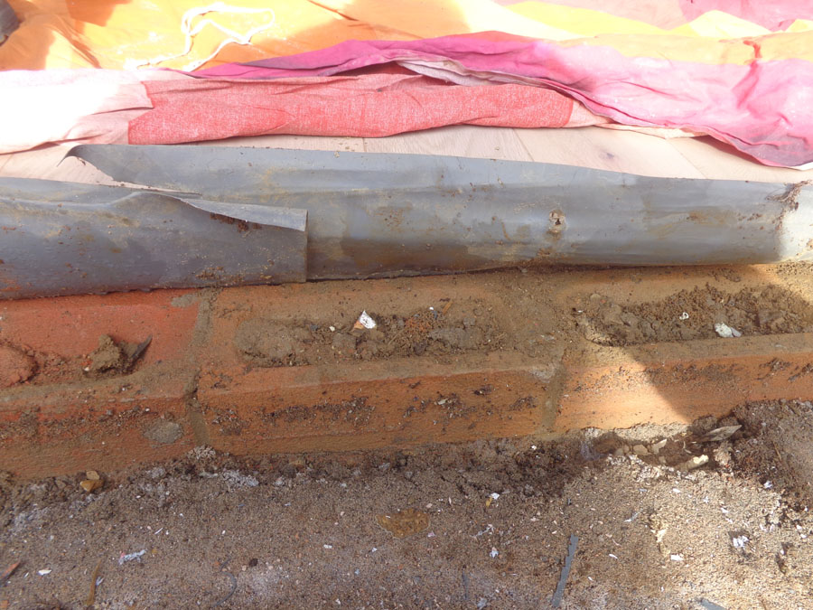 We get to see the impact of the missing silicone sealant. The wet brick.s which were the source of cold damp air.