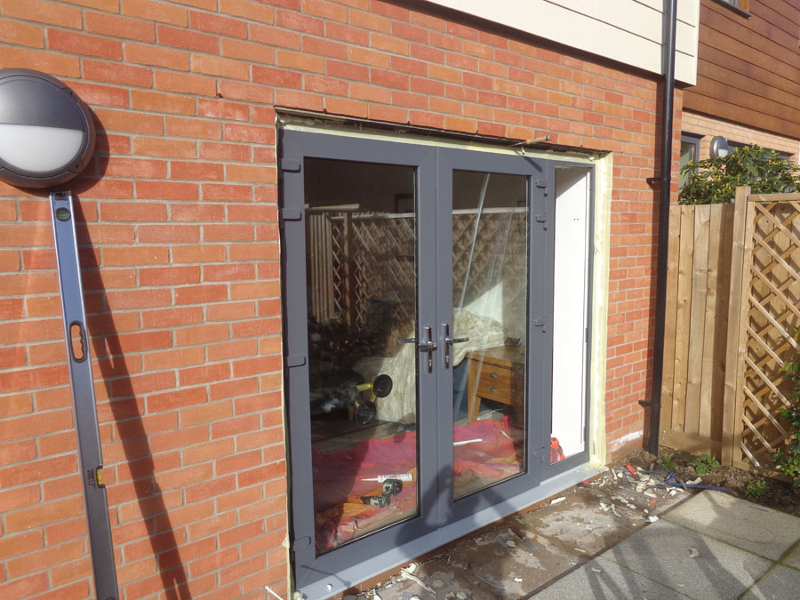 Frame back in, doors connected and frame ready for sealing with expanding foam