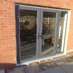 French doors re-installed with expanding foam around frame.