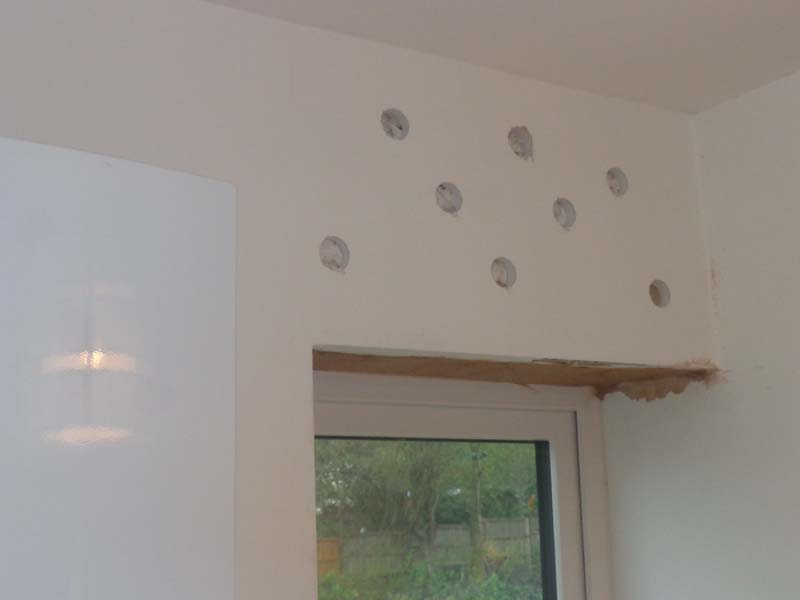 Utility room plasterboard cavity filled with sealant